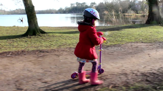 Little Girl On Her Scooter video