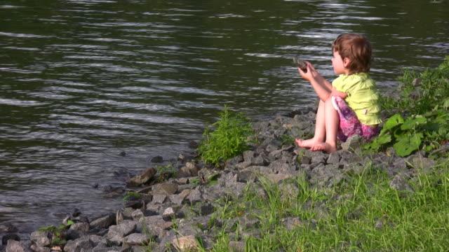 Little girl on pond video