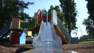 Little girl on slide in park video