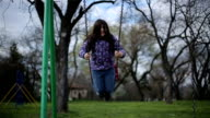 little girl on swing close up video