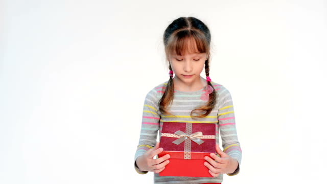 Little girl opening her gift video
