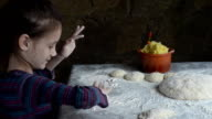 Little girl painstakingly sculpts cakes with potatoes video