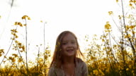 little girl picking flowers and throws up petals video