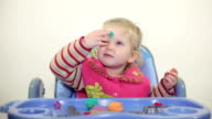 little girl play with plasticine video