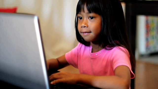 Little Girl Playing Games On A Lap Top Computer video