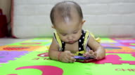 Little girl playing mobile smart phone video
