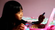 Little Girl Playing On Pink Laptop Computer video
