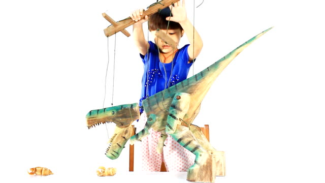 Little girl playing the marionette video