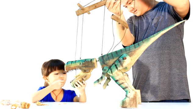 Little girl playing the marionette with papa video