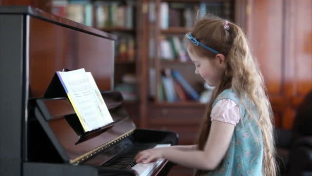 Little girl playing the piano video