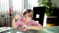 Little girl playing video