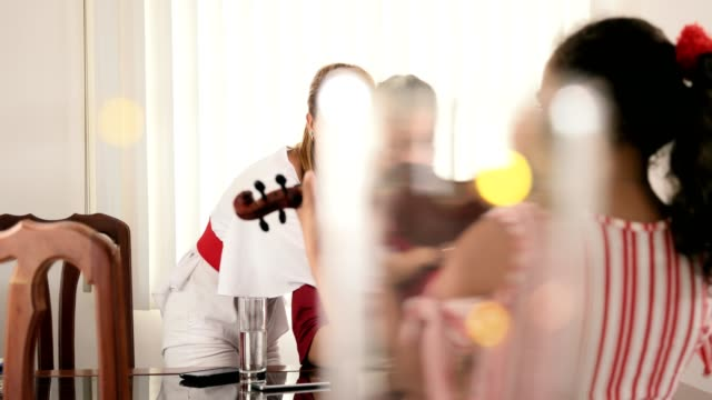 Little Girl Playing Violin In Front Of Proud Father Mother video