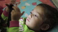 Little girl playing with a digital smartphone video