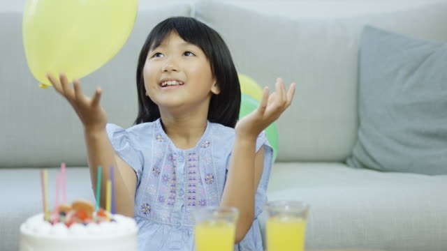 Little Girl Playing With Balloon video
