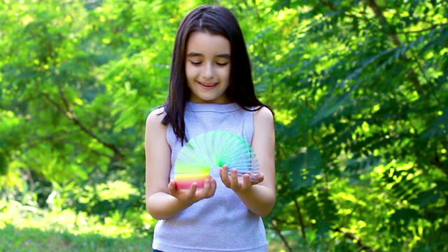 Little girl playing with toy spring video