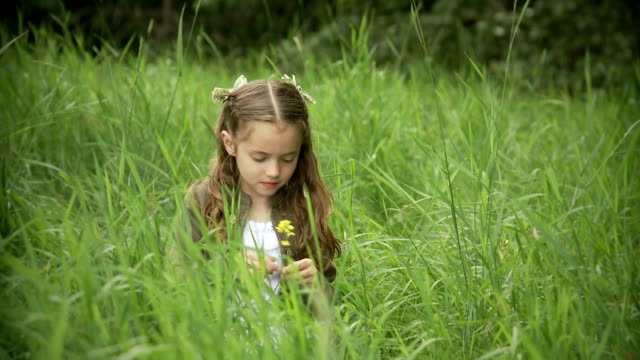 Little girl plays alone outdoor video