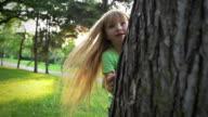 Little girl plays hide and seek video