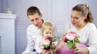 Little girl plays with her mother and father video