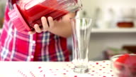 Little Girl Pouring Fresh Healthy Strawberry Smoothie video