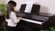 Little Girl practices piano video