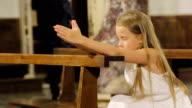 Little girl praing in the church video