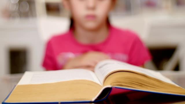 little girl reading a book-timelapse video
