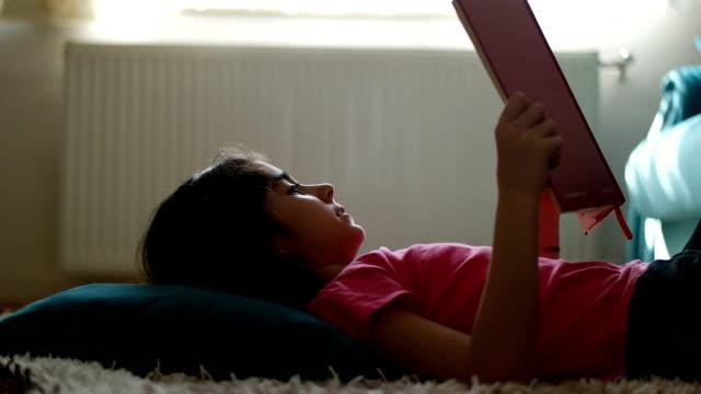 Little girl reading book video
