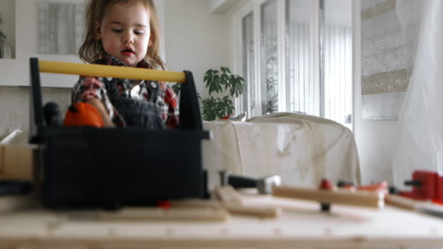 4K - Little Girl Renovation Construction Playing Living Room video