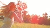 SLO MO TS Little girl running across a sunny meadow video