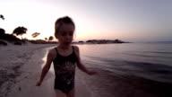 Little Girl Running At The Beach At Sunset video