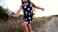 little girl running in nature video
