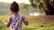 Little girl running in the garden video