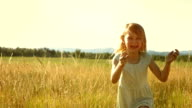 MS TS SLO MO Little Girl Running In The Grass video