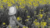 HD SLOW MOTION: Little Girl Running Through Canola Field video