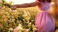 SLO MO Little girl running with bunch of flowers video