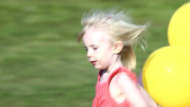 Little Girl Runs with Balloons video