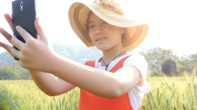 Little girl selfie in the wheat field video
