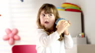 HD DOLLY: Little Girl Shaking Her Piggy Bank video