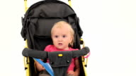 Little Girl Sitting In Pram And Smiling video