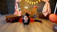 Little girl  sitting on the splits video