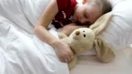 Little girl sleeping in her bed video