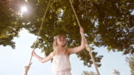 SLO MO Girl smiling on a swing video