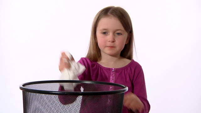 Little girl sneezes and sanitizes her hands video