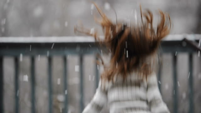 Little Girl Spinning In Falling Snow video