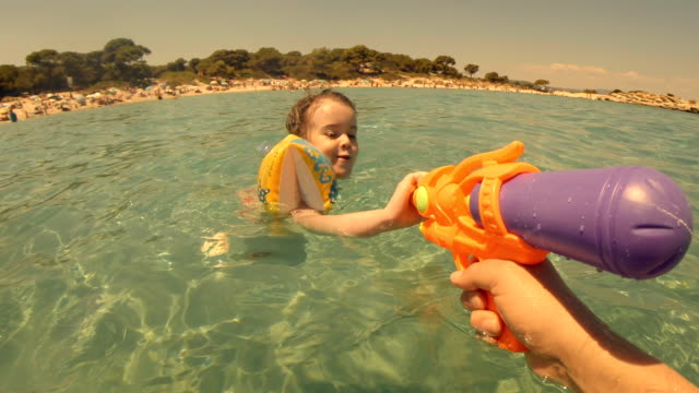Little Girl Swimming in the Sea And Splashing. video