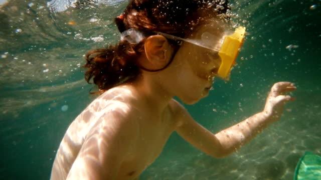 Little Girl Swimming Underwater in Sea video