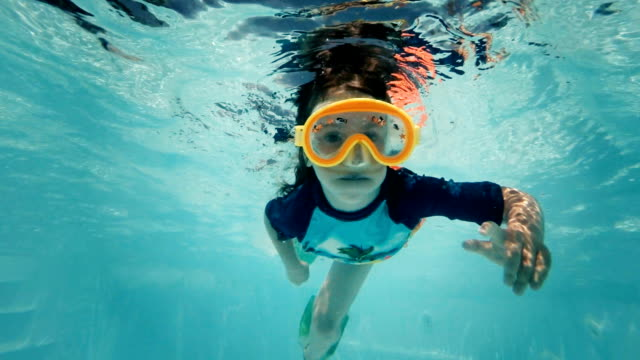Little Girl Swimming Underwater in Swimming Pool video