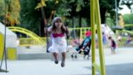 Little girl swinging on a swing video