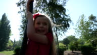 Little girl swinging video