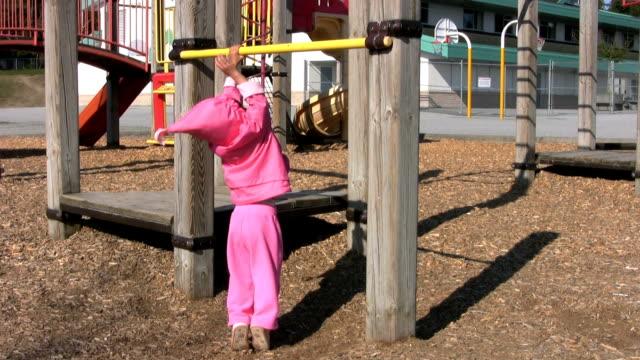 Little Girl Swings From Bar (HD 1080p30) video